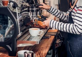 Coffee Shop Worker Making Coffee