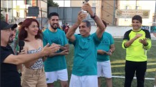 Accepting the trophy for the Drug-Free World tournament in Cagliari