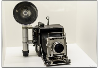 Example of a Graflex camera with flash gun.