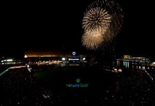 Fireworks and Projected Laser Graphics to Music at Stadium Event