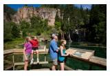 A family enjoys the views at Hanging Lake