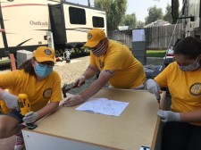 When the RV a family lived in was destroyed by the fire, Volunteer Ministers helped put together furniture for their new home.
