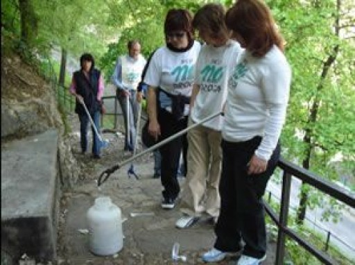Scientology Volunteers Hold Syringe Clean Up