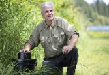 M. Banfield in the field with CDC mosquito trap