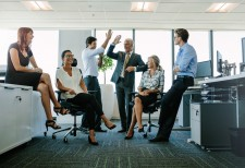 Group of Office Workers Sitting and Standing