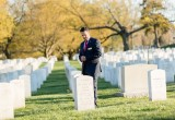 Jersey Memorial Group Principal David Hernandez, Jr. takes a moment to reflect at the grave of a NJ serviceman while visiting Arlington National Cemetery.