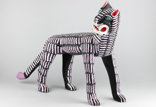 Black cat with white and purple stripes, Margarito Melchor, Maria Teresa Santiago, San Martin Tilcajete, 1987, courtesy of Tucson Museum of Art.