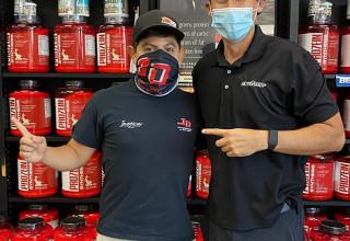 Xfinity race car driver Ryan Vargas with NUTRISHOP store owner Ronnie Villanueva