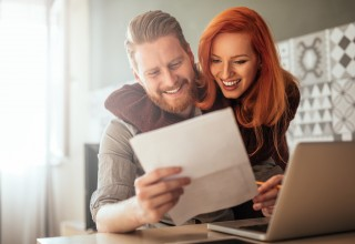 Happy Couple Looking at Finances