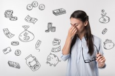 Woman Stressed by Finances, Including Student Loans
