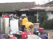 Volunteer Ministers in bright yellow jackets assisting the Stickles family sort through their remaining possessions.