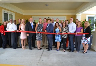 CEO, Richard J. Hutchinson, and senior management from Discovery Senior Living, cut the ribbon at Discovery Village at The Forum