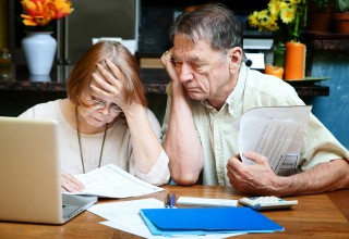 Senior Couple Looking at Finances