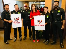 Minister Teresa Kok with members of Sabah's Wildlife Rescue Unit