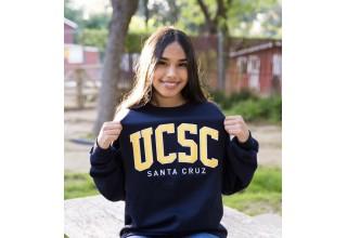 Campbell Scholar proudly wearing her college sweatshirt