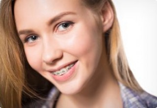 Schedule a Free consultation with the orthodontist to learn about Invisalign