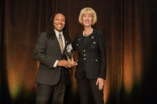 Jamison F. Gavin receiving 30 Under 30 Award with Julie Stroh, VP of UCF Alumni Engagement