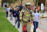 Pueblo County School District 70 conducts a school evacuation exercise with local firefighters at Liberty Point Elementary School, Pueblo, Colorado.