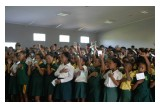 Kids pledge to live drug-free at a Foundation for a Drug-Free World presentation in Heidedal, South Africa.