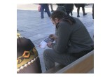 In Athens, a man engrossed in the copy of the Truth About Drugs booklet he received from volunteers from the Church of Scientology Athens at their drug prevention rally January 15, 2017, in Syntagma Square.