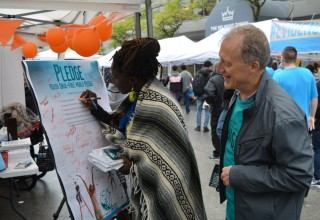 People mobilize to handle British Columbia's opioid crisis at the Foundation for a Drug-Free World booth at British Columbia's Recovery Day Festival.