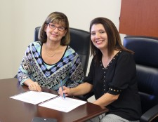 Lynn Fernandez, Chief Credit Officer at Lendistry (right) making it official.