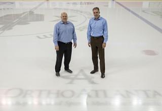 Atlanta Gladiators team president, Scott Henrichsen, and Brian E. Morgan, MD, OrthoAtlanta commemorate 15 year partnership