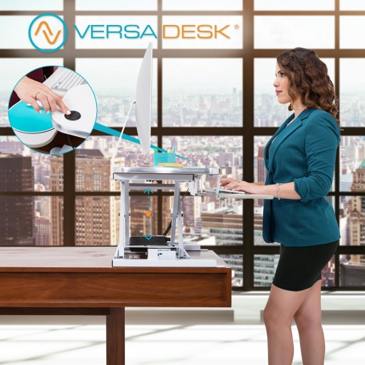 VersaDesk Electric Push-Button Adjustable Height Desk Risers Becomes Top Ergonomic Healthy Office Solution