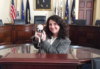 Rudi Taylor with Harley during a congressional hearing in Washington, DC