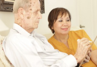 Care To Stay Home Caregiver engaged with a client
