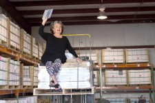 Lundy Wilder on a pallet of tile in Villa Lagoon Tile warehouse