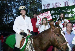As the sun set December 2, volunteers from the Scientology Church and Missions of Sacramento prepared to begin their ride down Fair Oaks Boulevard in this year's Christmas in the Village Parade of Lights.