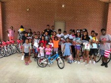 Robert Alford and 30 children with their new woom bikes