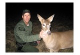 Officer Borkovich with deer that was hit by a car
