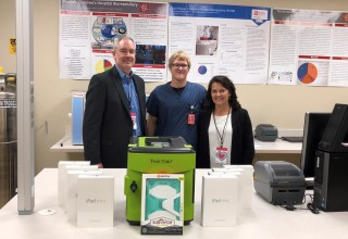 Walker Charities Founders, Brian & Diane Walker with iPad donations