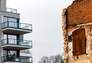 New Apartment Next To Crumbling Building