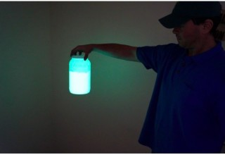 Holding a bottle of Glow in the Dark Pigment to make GLOW Filament