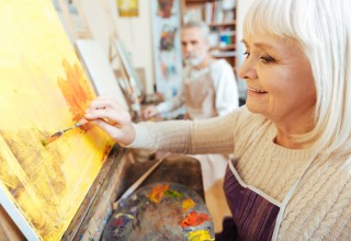 Older Woman Enjoying Painting